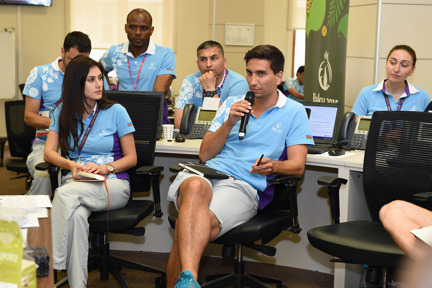 JTA's Christian Winkler updates the Games Operations Support Centre communications team during the daily briefing
