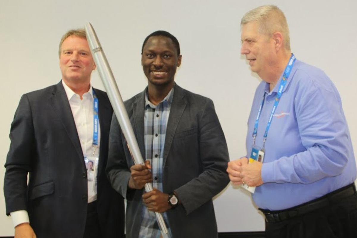 RIOU MSA student poses with the Sochi 2014 Olympic torch with Jon Tibbs (left) and Around the Rings Editor and Founder, Ed Hula (right)