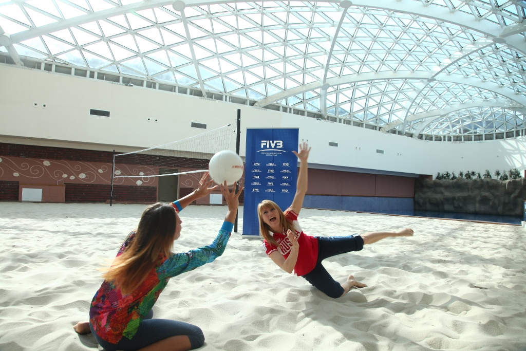 Svetlana Zhurova, 2006 Olympic champion in speed skating, and a Sochi 2014 volunteer enjoy a game of beach volleyball in Sochi 2014's Mountain Cluster