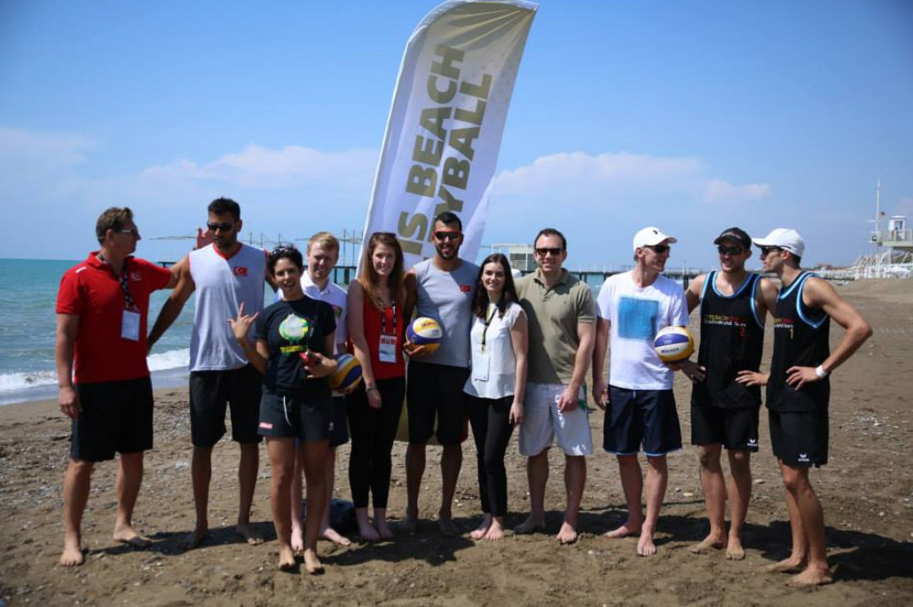 The professionals v the media and delegates who took part in an entertaining beach volleyball match